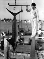 Man posing with a marlin.