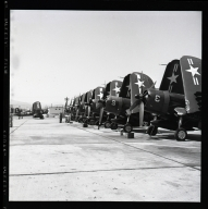 Navy prop planes being serviced at blimp hangar (Navy Station, Santa Ana).