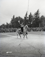 Los Angeles County Sheriff Eugene Biscailuz riding in the Pasadena Rose Parade. (1949-50?)