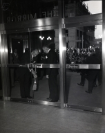 Dedication of the Los Angeles Mirror newspaper. The first issue was Oct. 10, 1948. L to R: Norman Chandler, publisher of Los Angeles Times; Virgil Pinkley, publisher of Los Angeles Mirror, as the unlock the door to the Mirror Building.