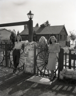 At home of Dr. and Mrs. J.H. McGrannahan, 432 Haines Ave. The girls are daughters and niece of Mr. McGrannahan outside the barn and the gate made from wagon and buggy wheels.
