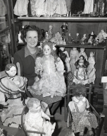 At home of Dr. and Mrs. J.H. McGrannahan, 432 Haines Ave. Mrs. McGrannahan is a collector of things like dolls and doll furniture, buttons, and napkin rings. The family built a wing on the house to show the collections, and converted their barn to a rumpus room.