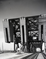 The Henry Ford Ave. Bridge. A counter weighted lift bridge that was on street level connecting Terminal Island to the mainland Long Beach.