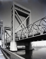 The Schuyler F. Heim Bridge (built by U.S. Navy). An upper story lift bridge connecting Long Beach via a freeway from Sepulveda Street & Anaheim with the Naval Station Long Beach. (1945-47)