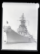 The IOWA, last of the great battleships and the most modern, is shown anchored in Long Beach Harbor before being sent to battleship graveyard.