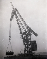 The first lift by the giant German crane at the Long Beach Naval Shipyard. This crane is lifting more than 100 tons of barge filled with seawater as a trial.