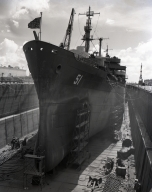 A cruiser is going through overhaul in the Moreel Drydock at Long Beach Naval Shipyard. Considered the largest in the world, it held the Queen Mary when she was brought to Long Beach.