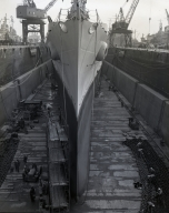 U.S. Navy cruiser, Springfield in the Moreel Drydock at Long Beach Naval Shipyard for repair and hull cleaning.