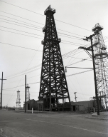 """Alamitos #1"" discovery well was brought in on June 25, 1921. Over 25 years late it is still producing oil. (June 25)"