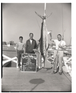Clem J. Holmberg posing with a marlin he caught.
