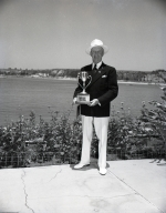 Tom Holliwell holding lawn bowling trophy.