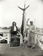 R. I. Launder posing with a marlin he caught.
