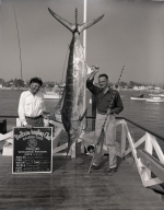 Dick Heller poses with a marlin he caught.
