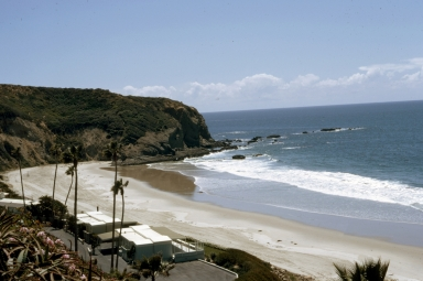 The private beach at the Dana Strand Club. Several residences appear in the foreground.