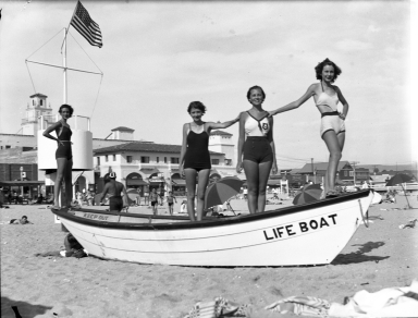 Models standing on a life boat