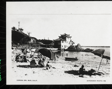 China House with people on the beach in the foreground.