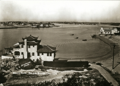 A view of China Cove, with China House to the left and the Kerckhoff Marine Laboratory to the right.  In the distance is the Balboa Peninsula and Balboa Island.