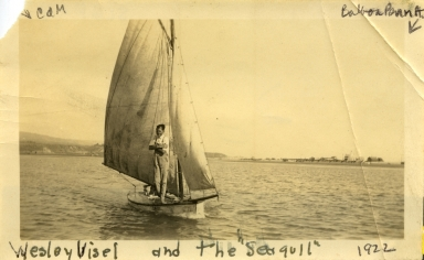 Wesley Visel and the sailboat <i>Seagull</i> in the ocean off the coast of Newport Beach.