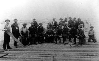 Group of men building McFadden's Wharf.