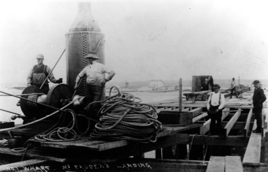 A gruop of men building McFadden's Wharf.