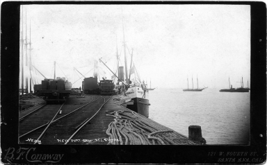 Newport California, wharf with ship Corona in background.