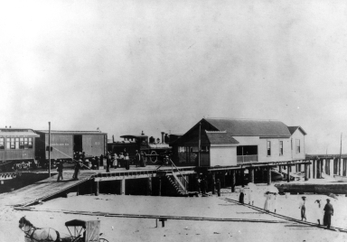 The Santa Ana and Newport Railroad depot at the base of McFadden wharf.
