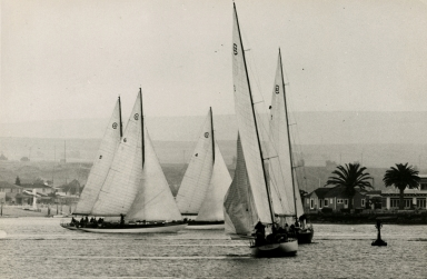 Sailboats in Newport Bay with Bay Island in in the background.