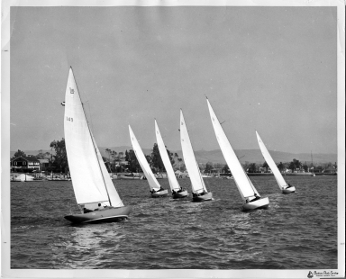 Sailboats racing in Newport Harbor, Harbor Island and Bay Island in background