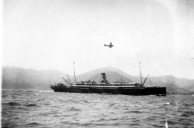 Steamship with airplane over it