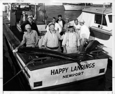 "Fishing boat ""Happy Landings"" with men and marlins"