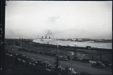 Empress of Britain, Canadian Pacific Steamship Company, in harbor, cars in foreground