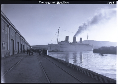 Empress of Britain, Canadian Pacific Steamship Company, docked, people on dock