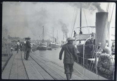 Ships at dock, men on dock, Sultana in foreground