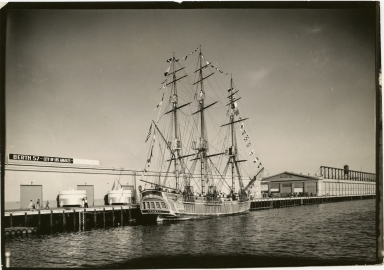 HMS Bounty replica at City of Los Angeles Berth 57 warehouse dock, deck crowded with people
