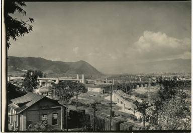Glendale-Hyperian bridge in distance, Los Angeles River, train tracks, hills
