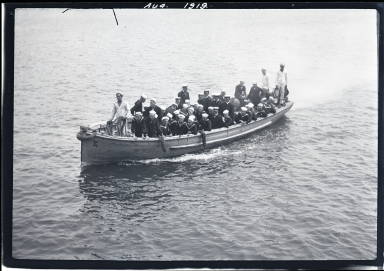 Sailors in shoreboat in harbor