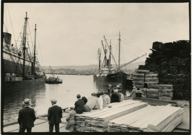 Lake Frances at lumber dock, people in foreground, steamship on left