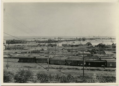 Trains, train tracks, main channel, lumber yards, ocean