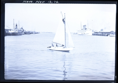 Neva in harbor, SS Yale, Pacific Navigation Company, and SS Admiral Dewey, United Fruit Company, at docks