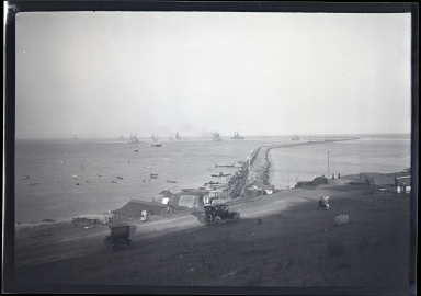 Pacific Fleet, ships, breakwater, old cars on shore