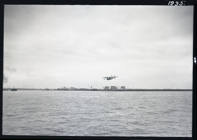 Pan American Airways System plane landing in outer harbor; 2 prints (1 closeup)
