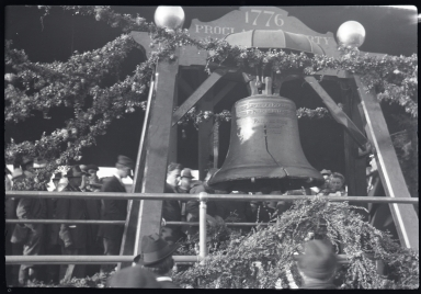 Close up of Liberty Bell on display, spectators