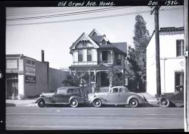 Old home on Grand Avenue, cars