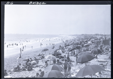 People on beach, umbrellas