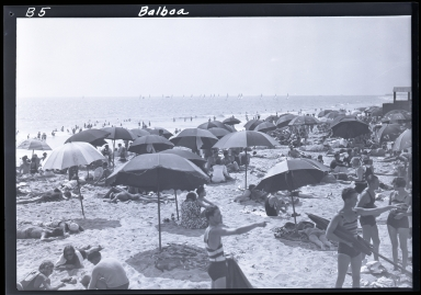Crowded beach, umbrellas