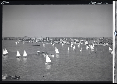 Balboa Island, ferry, sailboats, Corona del Mar in background