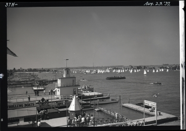 View from Pavilion of ferry landing, Lido Isle in far left, sailboat race
