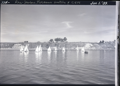 Boats near harbor entrance, Corona del Mar bluffs, hills
