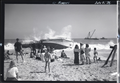 People viewing Kingfisher wreck, dredger