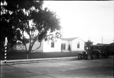 Library, old car in front